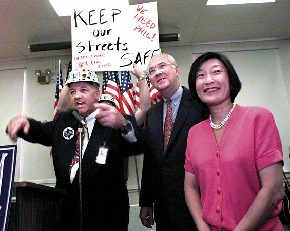 """State Senator elect Tommy Merritt leads a group of Gramm supporters in a """"Turnaround Longview"""" chant of """"Up with hope, down with dope"""" as U.S. Senator Phil Gramm and his wife Wendy watch at the conclusion of Gramm's speach Saturday morning in Longview.  Lester Phipps, Jr."""