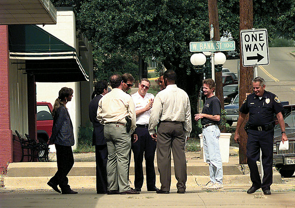 LongviewAssistant Fire Chief Bill Parrymore talks with Secret Service agents on Central and Bank Streets Tuesday as they make preparations for President Bill Clinton's Friday visit. Assitant Police Chief Leroy Hamilton is at right. Chris Matula photo.