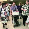 """Hallsville High School special resources teacher David Berry visits with students as he moves his materials to his next """"classroom"""" during period change.  Lester Phipps, Jr."""