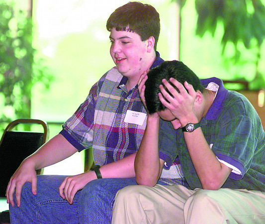 David Price left, and Steve Knight, both Pine Tree High School  students, they both competed as a team Thursday afternoon at the 1997 Geography Bowl at the Michelob room in Longview. Steve right, thinks about a question that was asked during the last moments of the bowl, they went on to win the bowl. Kevin Green