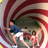 Jonathan,7 left, and Cassie Scott, 4, try to keep their balance in the rotating drum of the Magic Palace at the Northeast Texas Rgional Fair Tuesday evening. Matula photo.
