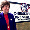 Judy Pollan the new Daingerfield School Superintendent in front of the school sign in Daingerfield Thursday morning> Kevin Green