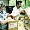 Jean Haberberger, left, the personnel manager and bookkeeper for the Salvation Army in Longview, and Jackie Gardner, right, receptionist and social woker fold boxes together to send items to the flood victims in North Dakota. Kevin Green