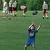 White Oak ball boy Barrett Blankenship, 7, does a little football practice of his own as the Roughnecks work out recently. With practice in full gear many local teams will be starting scrimmages Friday evening. Matula photo.