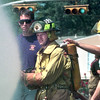 Dale Alexander, left, a fire instructor at Kilgore College and also a LFD Fireman, watches as Aaron Bucy, center, with the Jacksonville fire department, uses the fire hose, and Brent Modisette, right with the Lukin fire department braces Aaron during an exercise for the 12 week fire academy at Kilgore College Thursday morning in Kilgore.Kevin Green