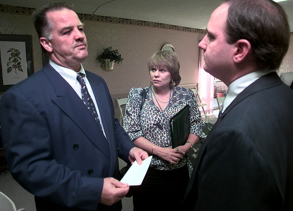 State Rep. Tommy Merritt, left, talks with Candace Read, center, the patient relations/admissions person with Sunrise Healthcare corp., and David Russell, right the administrator for the Lynn Lodge in Longview, during a press conference at Highland Pines Nursing Home in Longview Tuesday afternoon. Kevin Green