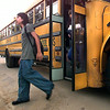 Patrick Hinkle, a 7th grader at Foster Middle School gets off the bus as he goes back to school Wednesday morning in Longview. Kevin Green