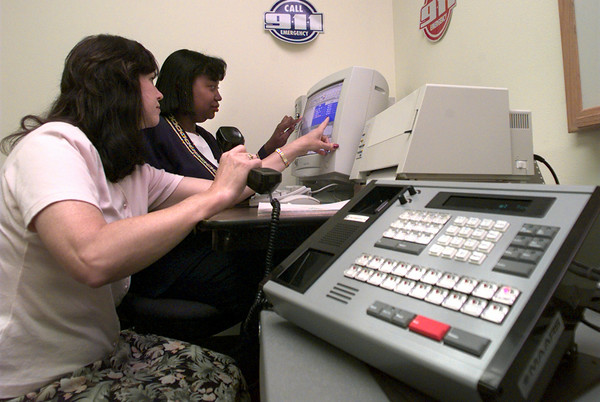 Carolyn Flores, left, the 911 coordinator for the East Texas Council of Governments, and Pattie Clayton, right the assistant 911 coordinator work with there new 911 training system at their office in Kilgore. Kevin Green