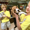 Tonya Parsons, right, is the owner of Wet Pets & Critters which offers an in home pet sitting service  with assistant Shannon Macket, right. Matula photo.