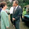 Texas Governor George W. Bush chats with Judy England outside her home Thursday after a press conference in her living room on the importance of the Saturday election over tax cuts for home owners. Judy and her husband Ron, in white behind the Governor, figured they will save $127. Matula photo.