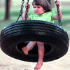 Lacy Jade Spencer-2, the daughter of Leah Jawaine Spencer of Longview enjoys the tire swing at Teague Park Friday afternoon in Longview. Kevin Green`