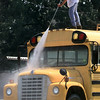 David Page, of Glenwood, washes  a newly acquired church bus at Baptist Tabernacle on Gilmer Rd., Monday afternoon in Longview. Kevin Green