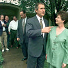 Texas Governor George W. Bush talks with Judy England of Kilgore outside her home after staging a press conference Thursday in her living room. Bush is on a state-wide tour to promote a tax cut for home owners. Judy and husband Ron, in white, figured they would save $127. Matula photo.