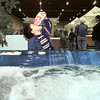 Nathan Crow, 5, gobbles up the free popcorn while looking at a jacuzzi Saturday during the ET Home Show at Maude Cobb. The hot tub was a display at Elite Pools' exhibit. Matula photo.