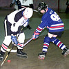 # 4 Dwayne Mast with the Sting battles for the puck as #99 Ron Wise trys to get it from him. Kevin Green