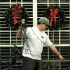 A man who asked not to be identified brings down his holiday cheer Wednesday in the 3200 block of Lopez. With the season finally over, its back to the daily routine in the Longview area. Matula photo
