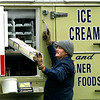 It's never too cold for ice cream as Schwan's Ice Cream & Finer Food deliveryman Mike Southerlin makes a stop in the 1300 block of Heather in Longview Tuesday in 30 degree weather. Matula photo.