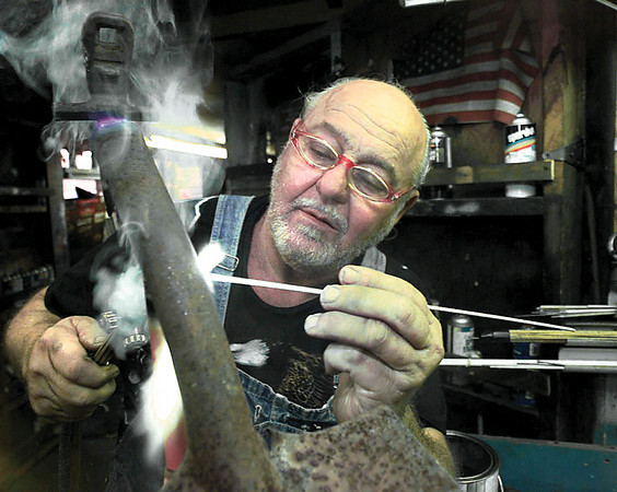 Dean Jester creates a bird from an old shovel head and part of a bicycle frame.  Lester Phipps, Jr.