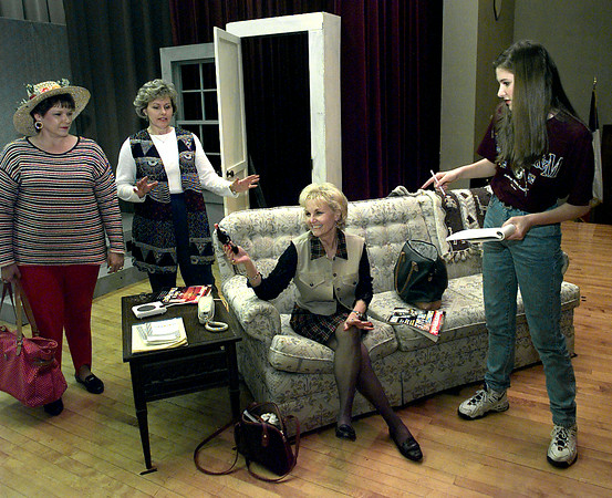 Suzanne Cappel, Judy Spivey watches as Peggy Bowne gets some directing on how to hold the gun by Mandy Mitchell During the rehearsal for the play Steel Magnolias. The students are directing the play and the teachers are the actors. Kevin Green