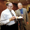 Longview City Attorney Larry Schenk and retiring police chief Johnny Upton share a laugh during a retirement party for the Chief Wednesday afternoon at City Hall.  Lester Phipps, Jr.