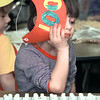 Spring Hill Elementery kidergartener Mallorie Anderson Is too mathematically inclined to truly enjoy the 100th day activities at the school. The children had to each place 100 pieces of a candy or nut on a piece of paper and she finished rather quivkly, leaving her with nothing to do for a while. Matula photo.