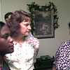 Sheniqa Evers ,left, and her mother Kathren Evers far right chatting with Family Partner Patty Richard center. Obie LeBlanc,