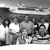 Evans Travel is best in ET. (sitting) Debbie and Evan Shelan. (standing) Dotty Kangas, Kerry Vick, Joanne Lewis, Richard Dowden, Lori Knuth, Kelley Brady and Christie Crawford. Matula photo.
