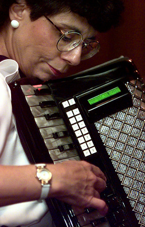 Betty Jo Simon plays for the Longview Accordian Club at Johnny Cace's Monday. Matula photo.