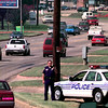 Cars apply their brakes as Sgt. John Thompson, traffic sgt. with the Longview Police Department, holds a handheld radar as he monitors traffic in the 400 blk. of Spur 63 Friday afternoon, as part of the Step program. Kevin Green