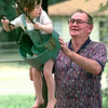 Camille St. Louis-3, left, looks down at her grandfather C. E. Anderson, right, of Longview, as he pushes her in the swing Wednesday afternoon at Pather Park in Longview. Kevin Green