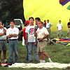 Bert Carollo, left to right, Bill Cunningham and Dennis Barrett,  all balloon pilots, watch as they wait for the final word from Bruce Bussey, right, to see if the low ceiling would ground the balloonists Friday morning in Longview. Kevin Green