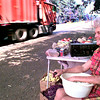 Imogene Robertson, of Pritchett, shells peas along US 80 outside WhiteOak,  as she watches traffic pass by her produce table, Thursday afternoon, she has been at this location with her vegatables for the last seven years. Kevin Green