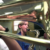 Charlie Stavinoha, in the reflection of his trombone, as Dennis Quinn, center, plays his tenor saxaphone while he looks up at Tod Sechrist, the band director for St. Mary's, during a band camp Tuesday morning at the campus. Kevin Green