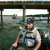 Sgt. Mike Walker with the Texas Parks & Wildlife Dept.'s Game Warden service patrols the Johnson Creek arm of the Lake Of The Pines Saturday. He will put in a shift from 7 a.m. to midnight. Matula photo.