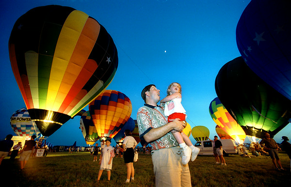 Stewart Green wows over the Friday night balloon glow with daughter Alexandra, 3,  during the opening festivities of the 1997 GTBR. Matula photo.