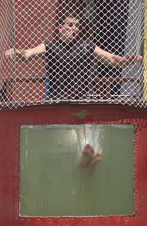 """Tommy Baker, Front End Manager for Sam's Club, takes a bath while sitting in the dunking booth in the store's parking lot during their 4th annual Special Olympics fund-raiser Saturday. The event featured a barbecue cook-of, games, antique cars and the Shriners' """"Mustang Patrol."""" Matula photo."""