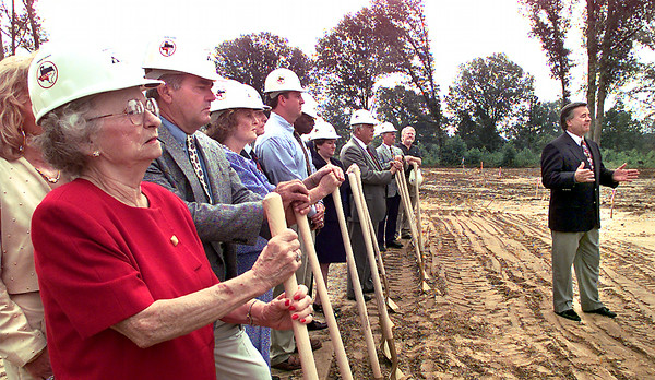 Constance Smith, left, and Denny Smith, second to left, and others listen as Gregg County Judge Mickey Smith speaks to a group gathered for the groundbreaking of the new Marvin A. Smith Juvenile Facility off of FM 1252 outside of Longview Wednesday morning. Kevin Green
