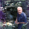 J.E. Stites feed the 134 Koi fish which reside in a pond he made himself four years ago. Matula photo.