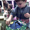 Bryan Harris-6, works on a hat during VBS at Church of the Holy Trinity United Church of Christ this past week in Longview. Kevin Green