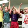 Left to right-Hayley Byron-7, Andrew Linthicum-7, Alexis Linthicum-6, Crista Smelley-5, learn hand motions to songs during vacation bible school at Church of the Holy Trinity United Church of Christ this week in Longview. Kevin Green