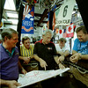 Bruce Bussey, Rick Ashby, Bill Bussey, Jim Birk and Wayne Bond look over the Longview map as they work out their strategy for this weekend's races for the Great Texas Balloon Race in the Bussey shop on Second St. Wednesday. Matula photo.