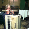 "Dennis Quinn, 13, straps on his ""box"" at the Accordian Club's meeting at Johnny Cace's Monday. Matula photo."