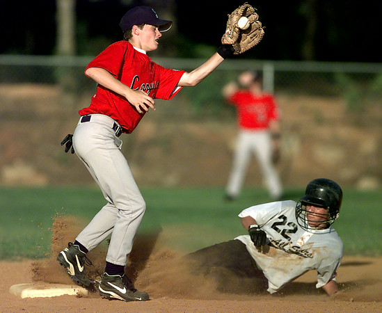 Longview's #10, Jared Stone closes his eyes as he gets the throw from home while County Line's #22, Wes Pugh slides safely Tuesday evening in McWhorter Park. This was 14 year-old All Stars. Matula photo.