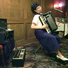 Accomplished accordianist Betty Jo Simon plays for the Longview Accordian Club at Johnny Cace's recently. She is hooked into an electronic MIDI program that allows her instrument to simulate numerous sounds. Matula photo.