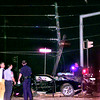 Longview Police and Fire personel look over the damage of a fatality wreck, while a utility pole hangs in the air, that occured on Gilmer Rd. at Spring Hill Rd. , Sunday morning around 2:00 am. Kevin Green