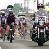 Longview Police Department motorcycle officers and bicycle officers escort the coast-to-coast bicycle riders into town on West Marshall Tuesday morning as they ride through Longview during a 3,000 mile ride across the country. Kevin Green