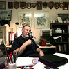 Rev. John Whitfell of Kilgore sits in his office filled with plaques from his service as a Navy chaplain, retiring a Captain. He is now a Catholic priest working to start a parish in Overton. Matula photo. Matula photo.