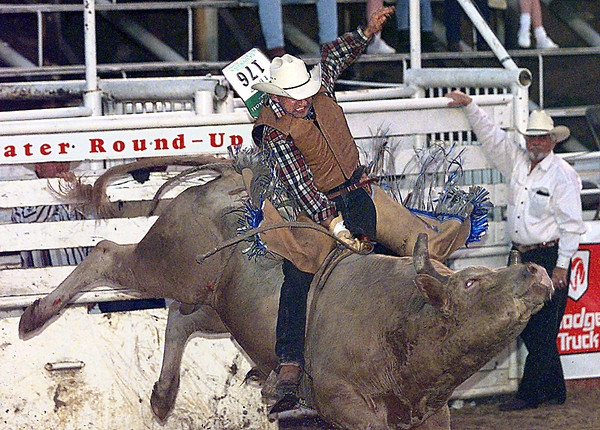 Chad Klein from Jackson, La., takes his ride in the bull riding competition during the Wednesday night Gladewater Rodeo Roundup. Matula photo.