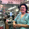 Nora Pereyda, a GED grad, stands in the front room of  Heritage Antiques & Collectables store that she owns in Gladewater. Kevin Green