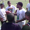 Earnest Hunter talks to a group of boys during the HYPE Sports Camp at Longview High School practice field Thursday morning. Kevin Green